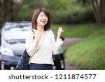 japanese lady of a middle... | Shutterstock . vector #1211874577