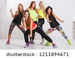 Group of smiling fitness girls...