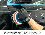 car polish wax worker hands... | Shutterstock . vector #1211899237