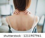 woman with neck pain  stiff neck   Shutterstock . vector #1211907961