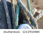 mooring bollard entwined with a ... | Shutterstock . vector #1211910484