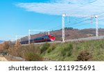 fast speeding up train in... | Shutterstock . vector #1211925691