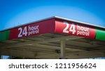 24 hour petrol sign at an asda... | Shutterstock . vector #1211956624