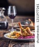 portion of roast duck leg red... | Shutterstock . vector #1211977261