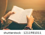 Small photo of Women tourists read book in quiet nature.