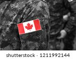 canada flags on soldiers arm.... | Shutterstock . vector #1211992144