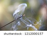 incense stick and smoke from... | Shutterstock . vector #1212000157