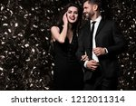 sexy couple on shine background.... | Shutterstock . vector #1212011314