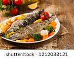 grilled whole trout. served...   Shutterstock . vector #1212033121