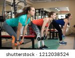 three young fitness active... | Shutterstock . vector #1212038524