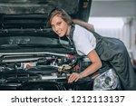 pretty woman in a black... | Shutterstock . vector #1212113137