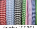 selling colorful stripy textile ... | Shutterstock . vector #1212150211
