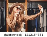 gorgeous blonde shopaholic... | Shutterstock . vector #1212154951