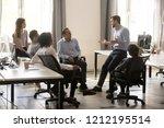 male team leader boss talking... | Shutterstock . vector #1212195514