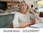 portrait of attractive senior... | Shutterstock . vector #1212240397