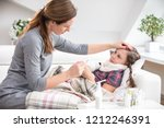 mother sits at the bedside of... | Shutterstock . vector #1212246391