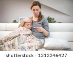 mother sits at the bedside of... | Shutterstock . vector #1212246427