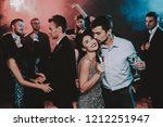 happy young people dancing on... | Shutterstock . vector #1212251947
