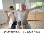 senior woman exercising with... | Shutterstock . vector #1212257431