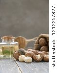 organic macadamia nut on wooden ... | Shutterstock . vector #1212257827