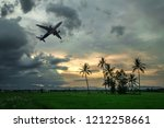 airplane with dramatic sky ... | Shutterstock . vector #1212258661