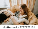 woman and her dog at home | Shutterstock . vector #1212291181