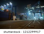 industrial port with containers.... | Shutterstock . vector #1212299917