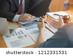 businessmen are discussing and... | Shutterstock . vector #1212331531