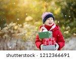 adorable little girl holding a...   Shutterstock . vector #1212366691
