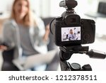 photo blogger recording video... | Shutterstock . vector #1212378511