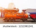 heavy red fuel truck ... | Shutterstock . vector #1212381241