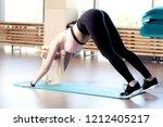 young yogi woman practicing... | Shutterstock . vector #1212405217