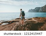 man traveler walking alone on... | Shutterstock . vector #1212415447