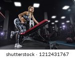 a young athletic girl does... | Shutterstock . vector #1212431767