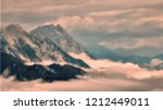 high mountain peaks rising from ... | Shutterstock . vector #1212449011