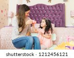 happy mother and daughter... | Shutterstock . vector #1212456121