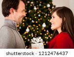 young couple exchanging... | Shutterstock . vector #1212476437