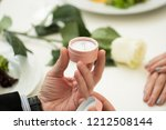 man making marriage proposal to ... | Shutterstock . vector #1212508144