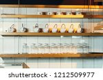 dishes on the shelves in the... | Shutterstock . vector #1212509977