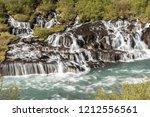 hraunfossar waterfall in...   Shutterstock . vector #1212556561