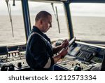 marine navigational officer or... | Shutterstock . vector #1212573334