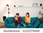 beautiful young couple sitting... | Shutterstock . vector #1212574444