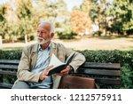 Handsome Mature Man Reading...