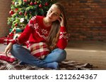 happy young woman sitting near... | Shutterstock . vector #1212624367