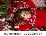 young cute smiling girl in red... | Shutterstock . vector #1212624394