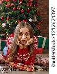 beautiful young woman lies... | Shutterstock . vector #1212624397