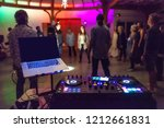 colorful dj mixing station in... | Shutterstock . vector #1212661831