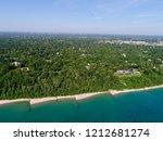 Highland Park Illinois aerial shot along the Lake Michigan shoreline early summer season. Beautiful calm lake.