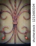 wrought iron gates  ornamental... | Shutterstock . vector #1212683104
