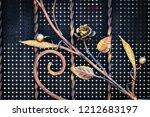 wrought iron gates  ornamental... | Shutterstock . vector #1212683197